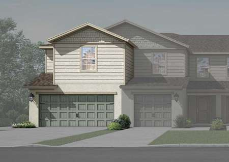 Two-story townhome with a two-car garage, a long driveway and front yard landscaping.