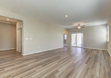 Penny family room with tiled floors, ceiling fan, and white-trimmed walls