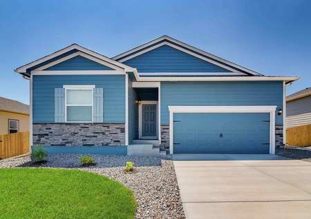 Chatfield floor plan exterior painted light blue with a two-car garage.