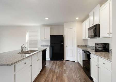 Camden kitchen with wood-looking tile flooring, white cabinetry, and granite countertops