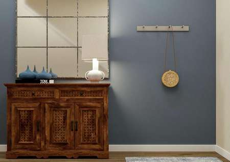 Rendering of the   entry hall focused on the blue accent wall, wooden console table and large   mirror.