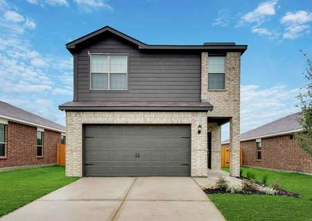 Jaguar exterior single family 2 story home with light brick and dark siding, 2 car garage and professionally landscaped front yard