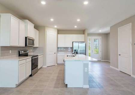The Sorrento floor plan kitchen to the left and a walk-way to the decorative front door to the right.