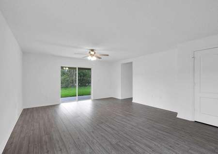 Spacious family room leading to a covered back patio for additional entertainment space.