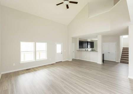 The Mid Atlantic Newport overview of living room area with vinyl wood floors and you can see entrance to the kitchen.