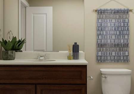 Rendering of second full bath with a   vanity with brown cabinets, a white toilet and gray shower curtain on the   right