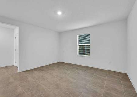 Sunnyside floor plan with recessed light, white on white walls, and brown ceramic flooring