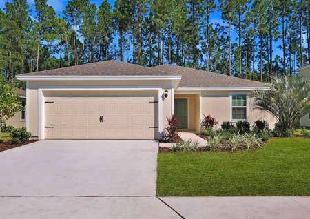Beautiful, single-story floor plan with a long driveway, two-car garage and gorgeous front yard landscaping.