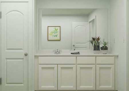 Rendering of bathroom with white   finishes, large mirror above sink, next to linen closet.