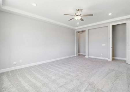 Bartlett finished floorplan with light color carpeting, walk-in closet, and ceiling fan and lights