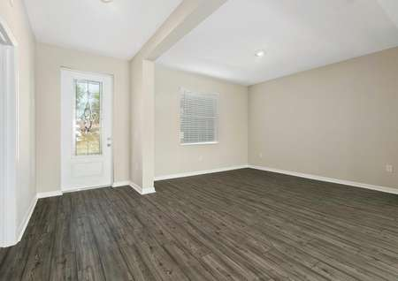 The home's foyer and spacious dining room feature luxury vinyl plank flooring and recessed lighting.