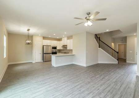 The home's beautiful entertainment space consists of a chef-ready kitchen overlooking the family room and a dining room.
