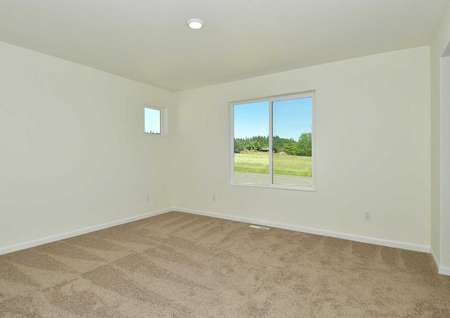 Cypress bedroom with white on white walls, white framed window, and soft brown carpet