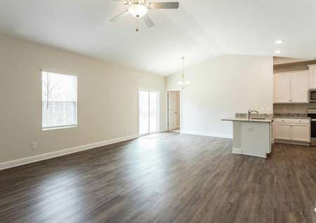 Alamance great room with wood-like flooring, granite kitchen, and vaulted ceilings