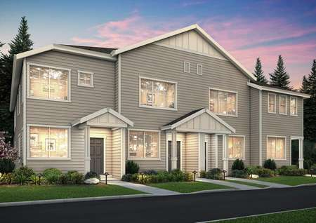 Angled view of the Harts Crossing townhome plans at night, focused on the left Apple unit.