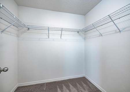 The master bedroom features its own walk-in closet with plenty of storage space.