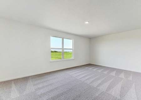 Travis loft space with large window, ceiling light and carpet.