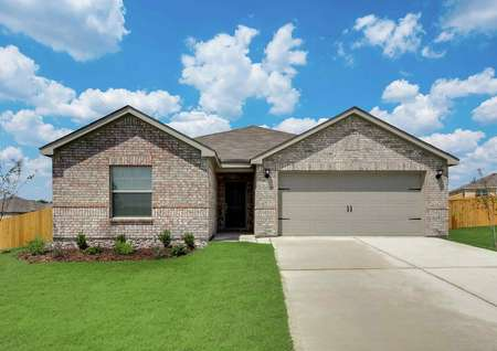 Sabine front exterior with single-story, brick finish, and lush green grass