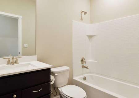 The Northwest Aspen second bath shown with a shower and bathtub combo and white quartz sink counter.