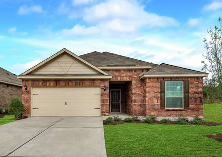 Reed new house plan exterior with brick façade, green grass landscaping, and two-car garage door