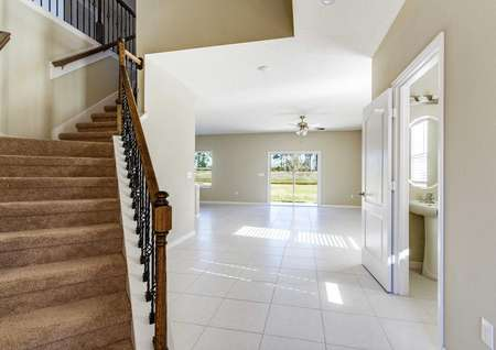Living room area with tile to the right and staircase to the left in the Tomoka floor plan.