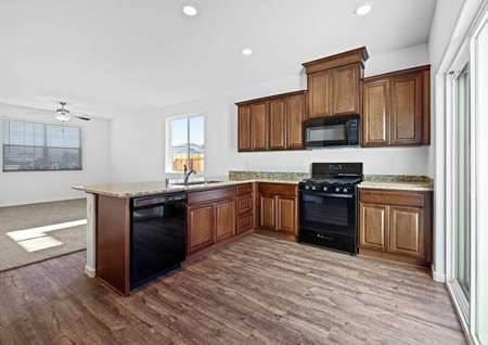 Chef-ready kitchen with brown cabinets, black energy-efficient appliances and granite countertops.