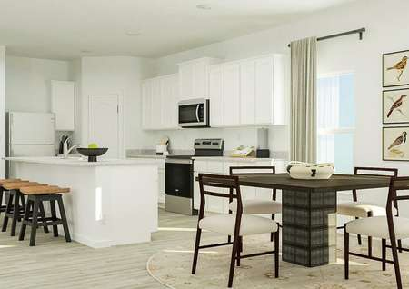 Rendering showing the dining area in   front of the spacious kitchen.