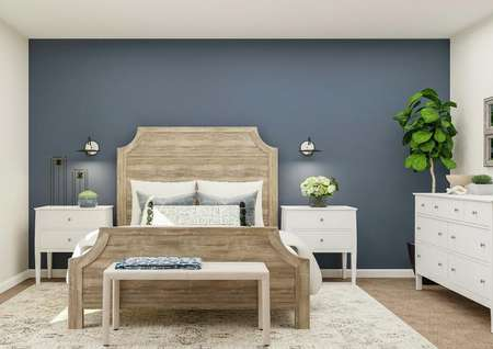 Rendering of a spacious bedroom in the   Newport plan. A light-colored wooden bed and two white nightstands are   against a blue accent wall, and a white dresser is on the adjacent wall.