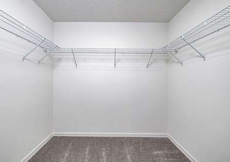 The master retreat features a walk-in closet with plenty of storage space.