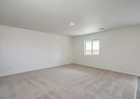 Spacious family room, perfect for game nights or lounging with family.
