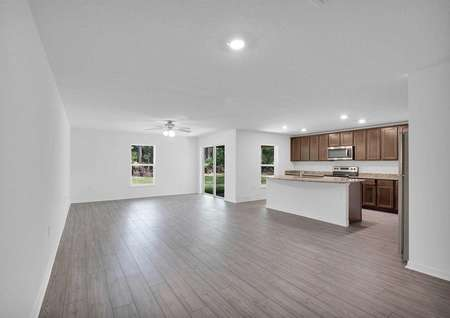 The family room stretching from the outdoor entertainment space to the chef-ready kitchen.
