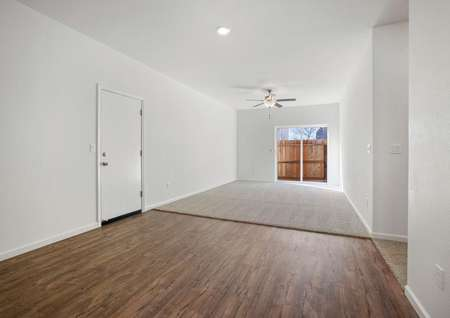 Incredible open layout plan with wood-style flooring and carpet.
