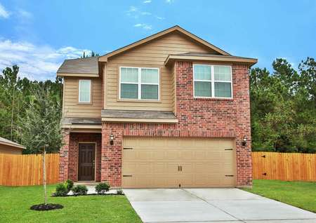 Photo of brick elevation of the Mesquite plan by LGI Homes with reddish brick and tan siding, front yard landscaping, wood fenced back yard and pine trees behind lot.