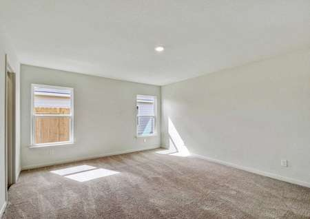 Hawthorn bedroom with two side yard windows, can light, and tan carpeting