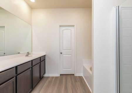 Cypress bathroom with separate bathtub and shower, ceramic flooring, and large white vanity