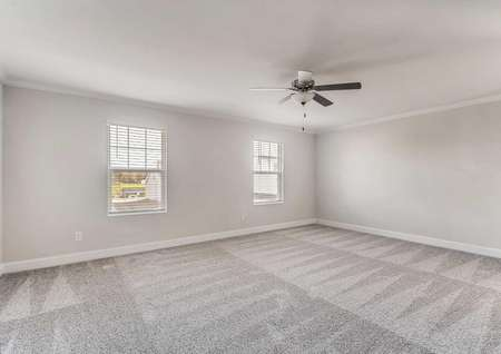 Hawthorn bedroom with ceiling fan, white on grey walls, and light grey carpets