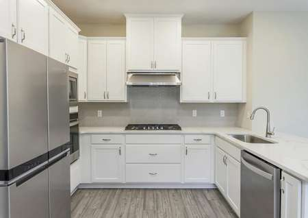 Stunning kitchen with quartz countertops and brand new stainless steel appliances.