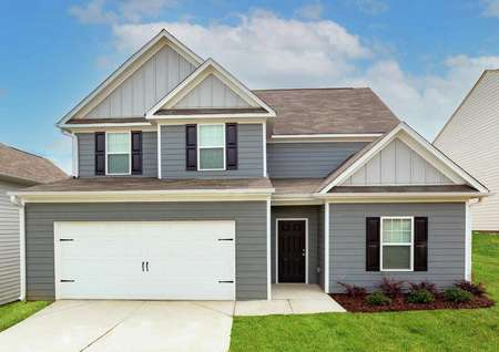 Hartwell floor plan exterior. Single-family, two-story home with two car garage and front yard landscaping.