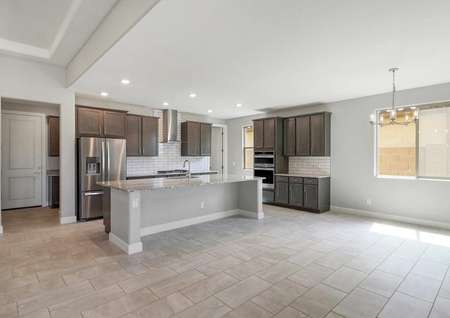 Hawley kitchen and dining nook with rectangular tiles, large kitchen island, and stainless steel appliances