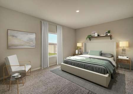 Staged master suite with tan bed and white chair in the corner.