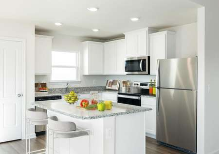 White kitchen cabinets with stainless kitchen appliances.