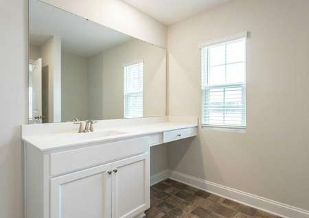Hartford master bath vanity with makeup counter, large mirror, and white finish
