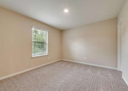 Ozark bedroom with window, carpet and ceiling light