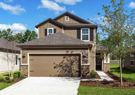Front view of the Tomoka floor plan with a light brown exterior and white trim around the decorative garage.