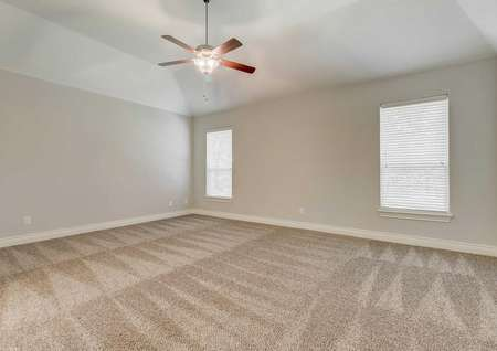 Fairview bedroom with two large windows with blinds, white trim and walls on gray paint, and light brown colored carpet
