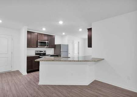 Kitchen featuring granite countertops, tall cabinets and all new appliances.