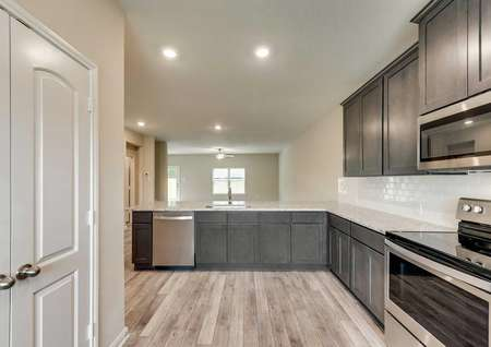 Tahoe kitchen design with granite counters, brown cabinets, and recessed lighting