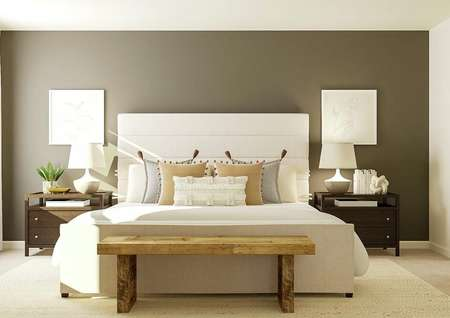 Rendering of the spacious master bedroom   with a large cream-colored bed and two nightstands against a dark gray accent   wall. On the left a window with white curtains and on the right is the   entrance to the attached bath.