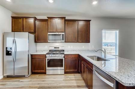 Arapaho kitchen with granite counters, stainless steel appliances, and undermount sink