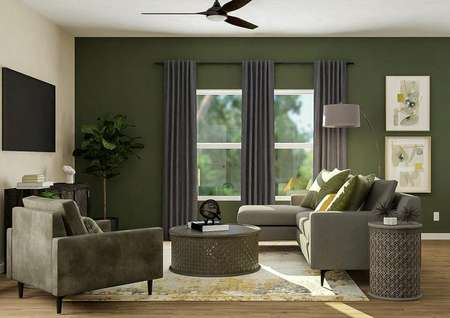 Rendering of living room with gray couch,   round coffee table, and large window